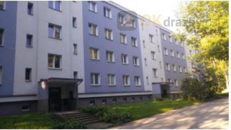 Dražba bytu 3+1 a dále podílu 65/1672 na spol. č.