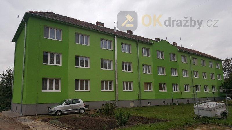 Dražba bytové jednotky 2+1 a dále podíl 5426/97858
